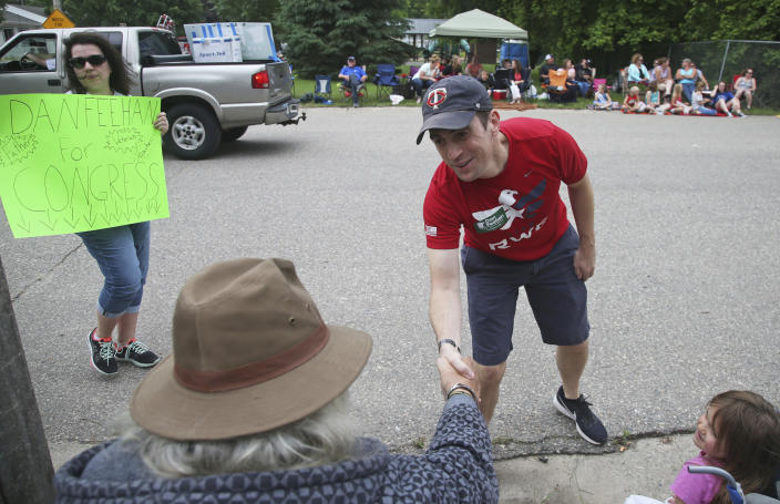 Dan Feehan, the Democratic candidate in Minnesota's First District, works a parade in Waterville, Minn., in June. (Photo: Jim Mone/AP)