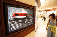 <p>A shopper walks past a monitor displaying hurricane information in several different languages inside a hotel Waikiki, Wednesday, Aug. 22, 2018, in Honolulu, Hawaii. (Photo: Marco Garcia/AP) </p>