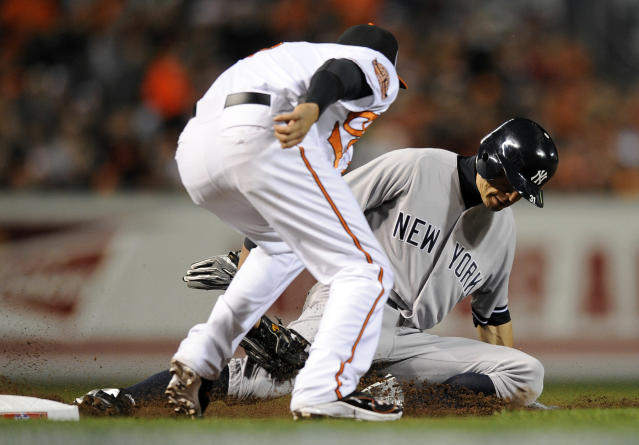 Baltimore Orioles third baseman Manny Machado tags out New York Yankees Ichiro Suzuki, of Japan, as he tries to steal third base in the first inning of Game 1 of the American League division baseball series on Sunday, Oct. 7, 2012, in Baltimore. (AP Photo/Nick Wass)
