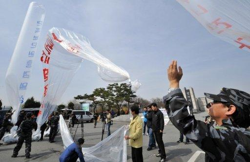 South Korean activists on Sunday launched leaflets across the border to the North criticising the Kim dynasty
