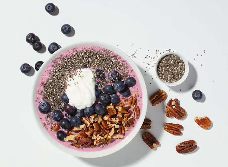 acai blueberry smoothie bowl on white background