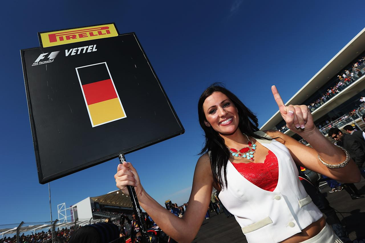 AUSTIN, TX - NOVEMBER 18:  Grid girl for Sebastian Vettel of Germany and Red Bull Racing is seen before the United States Formula One Grand Prix at the Circuit of the Americas on November 18, 2012 in Austin, Texas.  (Photo by Mark Thompson/Getty Images)