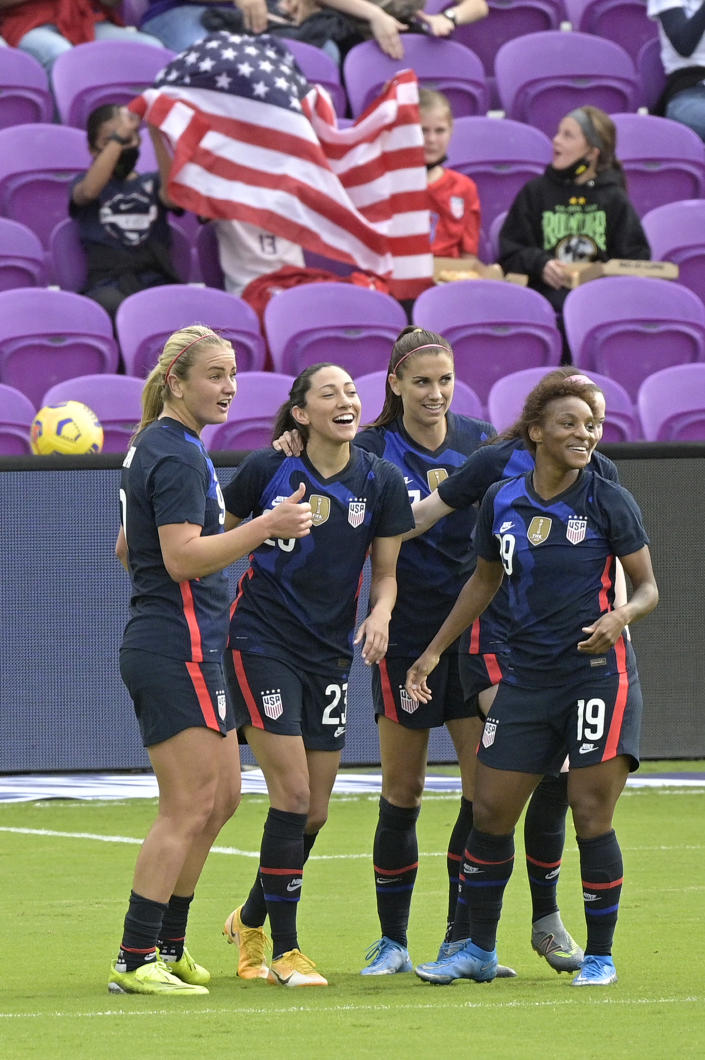 The United States forward Christen Press, second from left, is congratulated by teammates Lindsey Horan, left, Alex Morgan, and Crystal Dunn (19) after Press scored a goal during the first half of a SheBelieves Cup women's soccer match against Brazil, Sunday, Feb. 21, 2021, in Orlando, Fla. (AP Photo/Phelan M. Ebenhack)