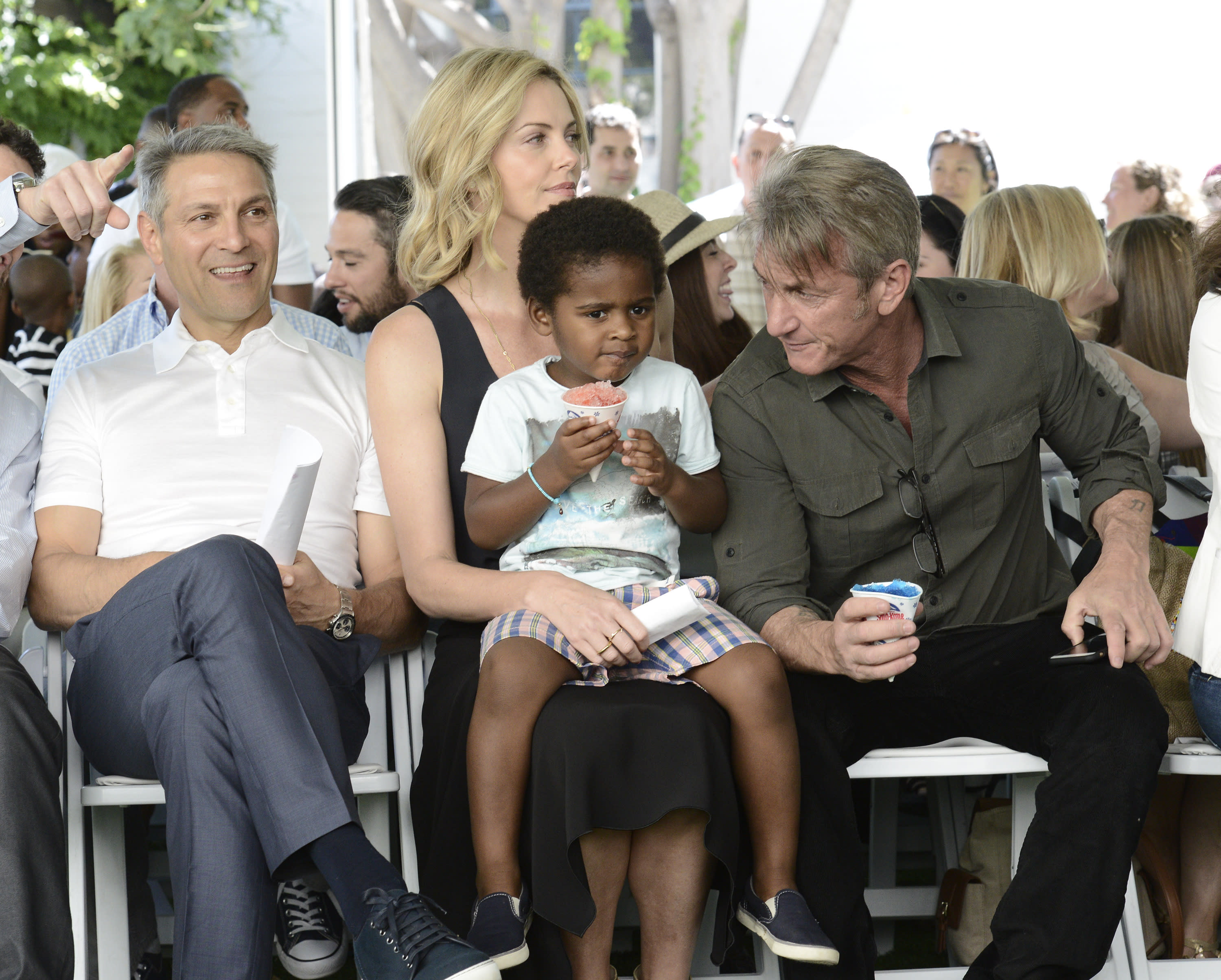 From left to right, WME Co-CEO Ari Emanuel, Jackson Theron, actress Charlize Theron, and actor Sean Penn attend the generationOn block party at Fox Studios in Los Angeles on Saturday, April 18, 2015. (Photo by Dan Steinberg/Invision/AP)