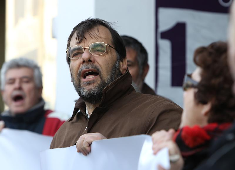Trade union protesters shout slogans  during a protest outside a pension fund office on Tuesday, March 6, 2012. Unions oppose the participation of pension funds in an upcoming debt-swap deal between the Greek state and private bond holders, warning that it could lead to steeper benefit cuts. (AP Photo/Thanassis Stavrakis)