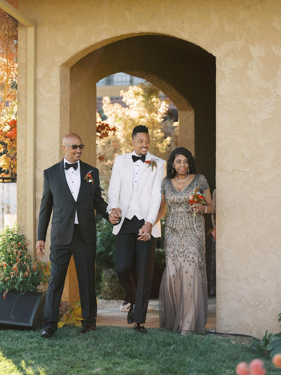 CJ walking down the aisle with his beautiful mother and father. His brother could not attend our wedding because he works abroad, so he made his father his best man.