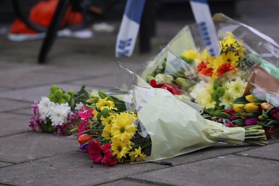 Flowers placed at the sight of Ayub's stabbing (PA)