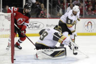 A shot by New Jersey Devils center Travis Zajac, not pictured, gets by Vegas Golden Knights goaltender Marc-Andre Fleury (29) for a goal during the second period of an NHL hockey game, Friday, Dec. 14, 2018, in Newark. (AP Photo/Julio Cortez)