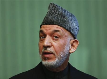 Afghan President Hamid Karzai speaks during a news conference in Kabul