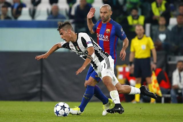 Juventus' forward Paulo Dybala fights for the ball with Barcelona's defender Javier Mascherano during the UEFA Champions League quarter final first leg football match Juventus vs Barcelona, on April 11, 2017 (AFP Photo/Marco BERTORELLO)