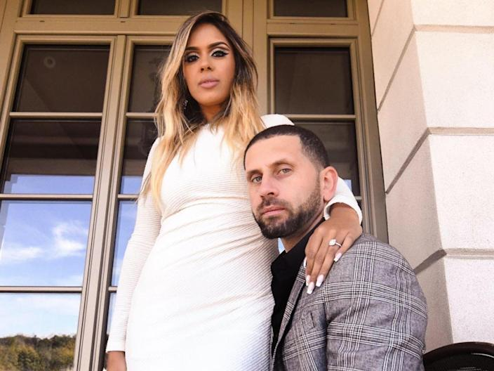 Vishnell and her husband pose for a photo outside