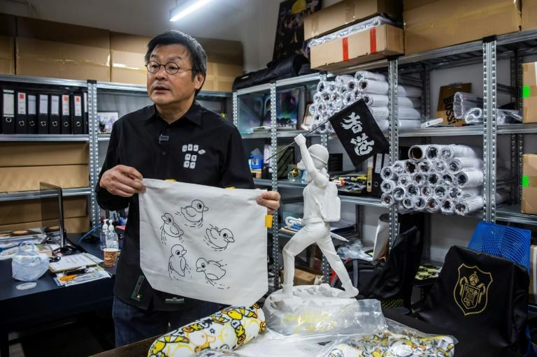 "Chow makes no secret of his messaging -- the tote bag, for example, carries a referemce to popular Hong Kong protest slogan ""Five demands, not one less"""