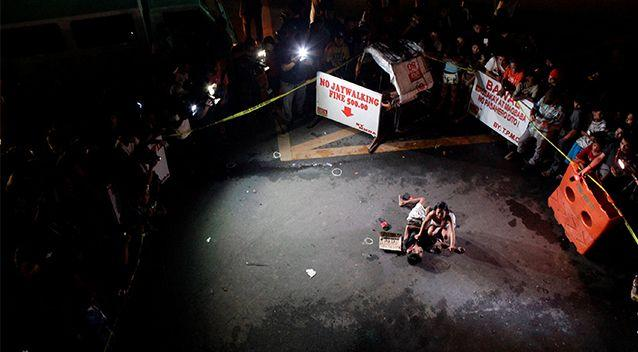 A woman weeps over the body of her husband, who was killed on a street by a vigilante group, according to police, in a spate of drug related killings in Pasay city, Metro Manila, Philippines July 23, 2016. Photo: Reuters/Czar Dancel