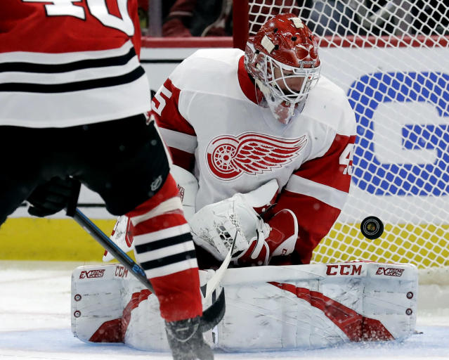 Detroit Red Wings goalie Jonathan Bernier blocks a shot against the Chicago Blackhawks during the second period of an NHL hockey game Sunday, Feb. 10, 2019, in Chicago. (AP Photo/Nam Y. Huh)