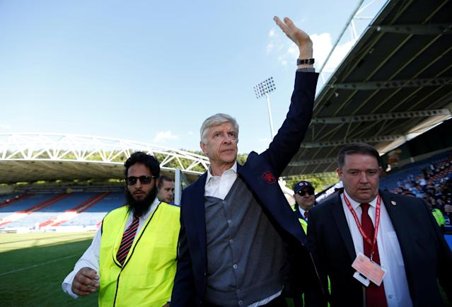 "Soccer Football - Premier League - Huddersfield Town vs Arsenal - John Smith's Stadium, Huddersfield, Britain - May 13, 2018 Arsenal manager Arsene Wenger waves to the fans after the match Action Images via Reuters/Andrew Boyers EDITORIAL USE ONLY. No use with unauthorized audio, video, data, fixture lists, club/league logos or ""live"" services. Online in-match use limited to 75 images, no video emulation. No use in betting, games or single club/league/player publications. Please contact your account representative for further details."