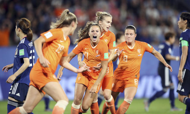 Lieke Martens, center, celebrates after her winning penalty sent the Netherlands past Japan in the Women's World Cup round of 16. (Associated Press)