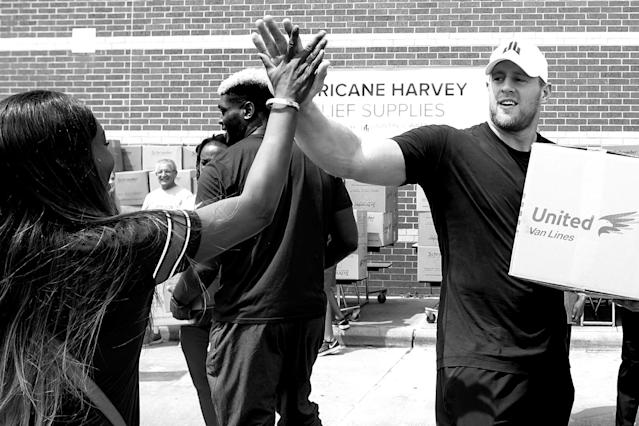 "<a class=""link rapid-noclick-resp"" href=""/nfl/players/24798/"" data-ylk=""slk:J.J. Watt"">J.J. Watt</a> loads a car with relief supplies for people impacted by Hurricane Harvey. Watt's relief fund raised more than $41 million. (Getty)"