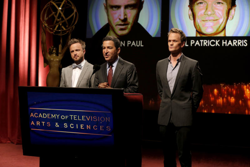Actor Aaron Paul, left, Academy of Television Arts & Sciences Chairman and CEO Bruce Rosenblum, center, and actor Neil Patrick Harris announce nominations at the 65th Primetime Emmy Nominations Announcements at the Leonard H. Goldenson Theatre at the Academy of Television Arts & Sciences, Thursday, July 18, 2013 in North Hollywood, Calif. (Photo by Todd Williamson/Invision/AP)