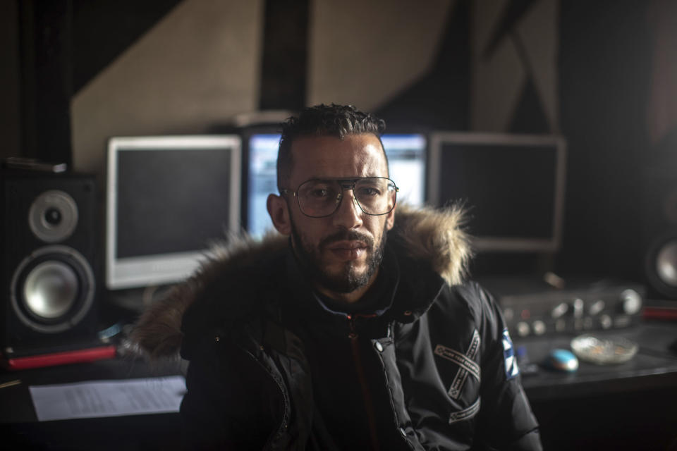 In this Thursday, Nov. 21, 2019 photo, Moroccan rapper Yahya Semlali, 31, known as LZ3er, poses for a portrait in his studio in Fes, Morocco. (AP Photo/Mosa'ab Elshamy)