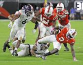 Miami running back Donald Chaney, Jr. (2) runs the ball in the first half of an NCAA college football game against Virginia in Miami Gardens, Fla., Saturday, Oct. 24, 2020. (Al Diaz/Miami Herald via AP)