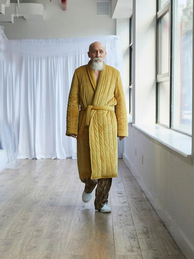 <p>Older male model wears a yellow robe and leopard trousers at the Collina Strada Fall/Winter 2018 show. (Photo: Jonathan Hokklo) </p>