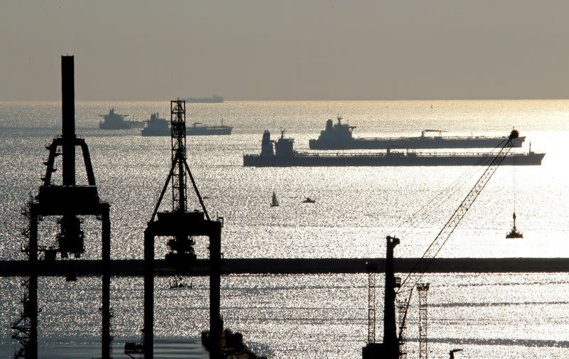 FILE PHOTO: Oil and gas tankers are anchored off the Marseille harbour