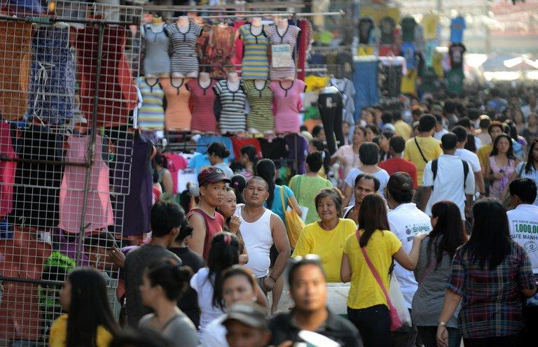 People can be seen shopping at Divisoria Market in Manila on October 29, 2012