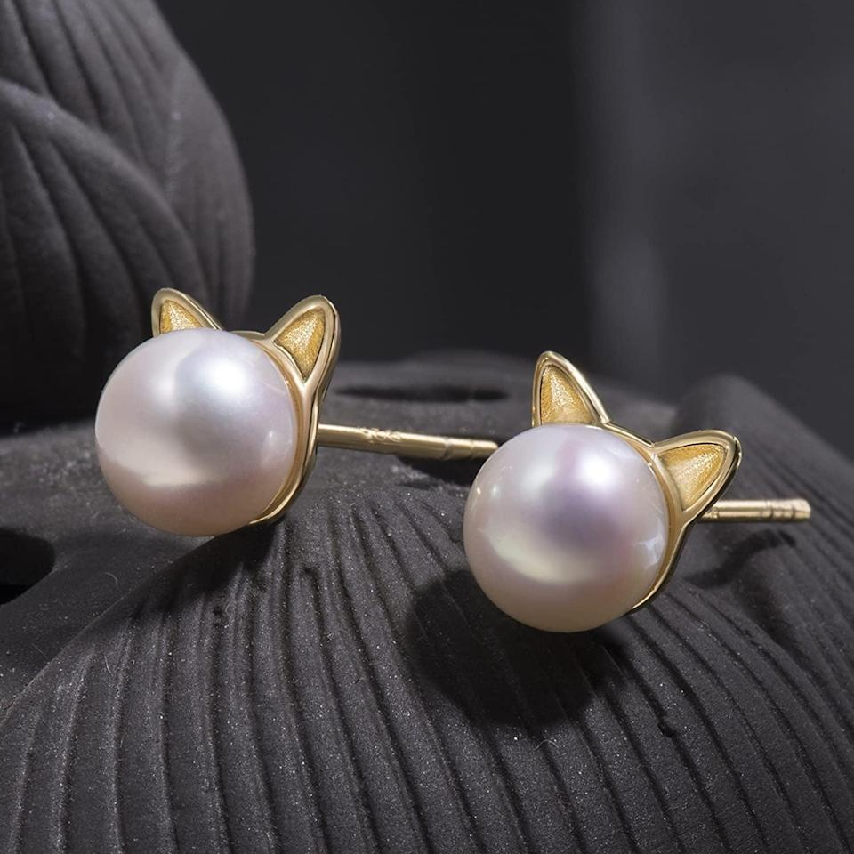 <p>Cat-lovers will obsesses over these <span>S. Leaf Cat Pearl Earrings</span> ($19).</p>
