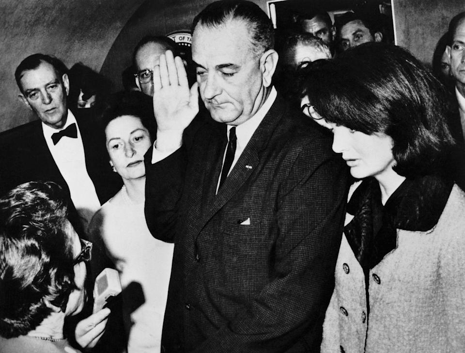 <p>Following the assassination of President John F. Kennedy, Vice President Lyndon B. Johnson is sworn into the office of the presidency aboard Air Force One.</p>