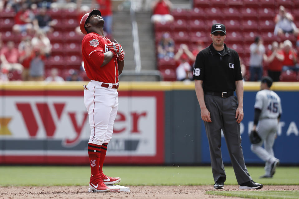 Cincinnati Reds' Yasiel Puig celebrates after hitting a two-run double off Miami Marlins starting pitcher Pablo Lopez in the fifth inning of a baseball game, Thursday, April 11, 2019, in Cincinnati. (AP Photo/John Minchillo)
