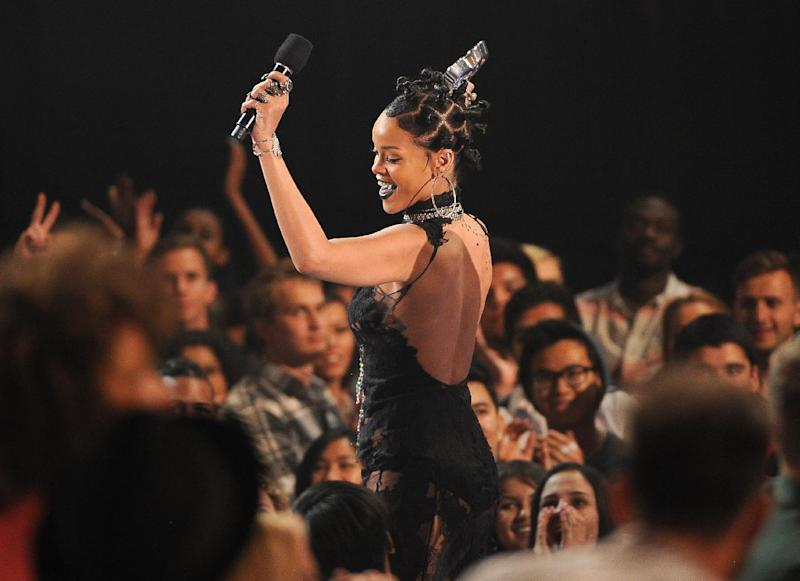 """Rihanna accepts the award for song of the year for """"Stay"""" at the iHeartRadio Music Awards at the Shrine Auditorium on Thursday, May 1, 2014, in Los Angeles. (Photo by Chris Pizzello/Invision/AP)"""