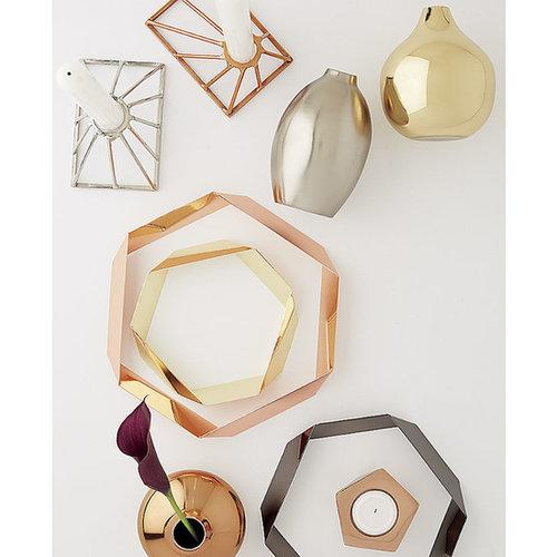 Mix and match your metals and keep hot plates off your sensitive surfaces with copper trivets ($20). They look great displayed decoratively, too!