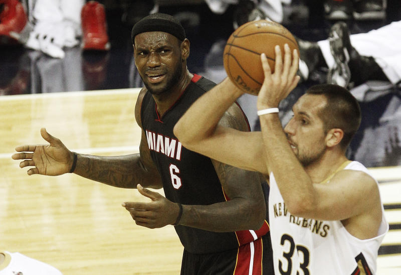 Miami Heat small forward LeBron James (6) complains to officials as New Orleans Pelicans power forward Ryan Anderson (33) grabs a rebound in the first half of a preseason NBA basketball game in New Orleans, Wednesday, Oct. 23, 2013. (AP Photo/Bill Haber)