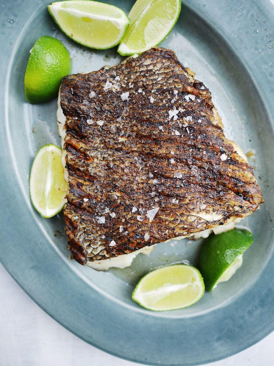 "<p>Don't be intimidated to grill fish!</p><p>Get the recipe from <a href=""https://www.delish.com/cooking/recipe-ideas/a21098903/best-grilled-fish-recipe/"" rel=""nofollow noopener"" target=""_blank"" data-ylk=""slk:Delish"" class=""link rapid-noclick-resp"">Delish</a>.</p>"