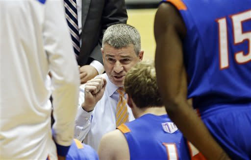 Boise State head coach Leon Rice urges his team on during a timeout in the first half of an NCAA college basketball game against San Diego State, Wednesday, Feb. 6, 2013, in San Diego. (AP Photo/Lenny Ignelzi)