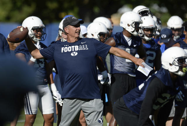 BYU football offensive coordinator and quarterbacks coach Ty Detmer works with the team during NCAA college football practice Thursday, July 27, 2017, in Provo, Utah. (Francisco Kjolseth/The Salt Lake Tribune via AP)