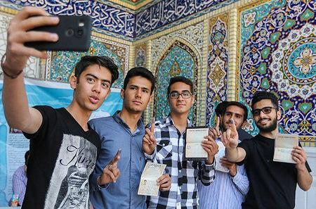 Iranians take a selfie after voting in a second round of parliamentary elections, in Shiraz, Iran April 29, 2016. Farsnews.com/Handout via REUTERS
