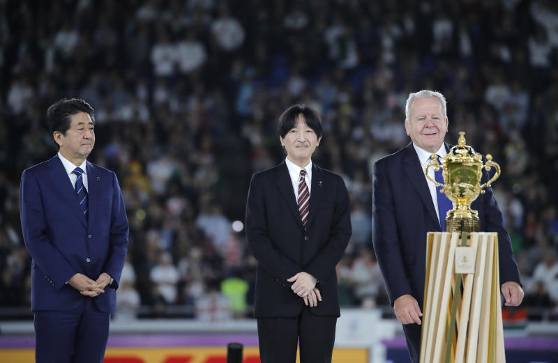 Japan's Prime Minister Shinzo Abe, Japan's Crown Prince Akishino and World Rugby chairman Bill Beaumont, from left, during the presentation ceremony after the Rugby World Cup final at International Yokohama Stadium between England and South Africa in Yokohama, Japan, Saturday, Nov. 2, 2019. (AP Photo/Christophe Ena)