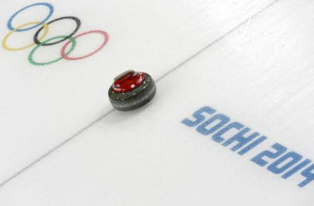 FILE PHOTO: A stone is seen during a women's curling round robin game at the 2014 Sochi Winter Olympics at the Ice Cube Curling Center February 17, 2014. REUTERS/Ints Kalnins/File photo