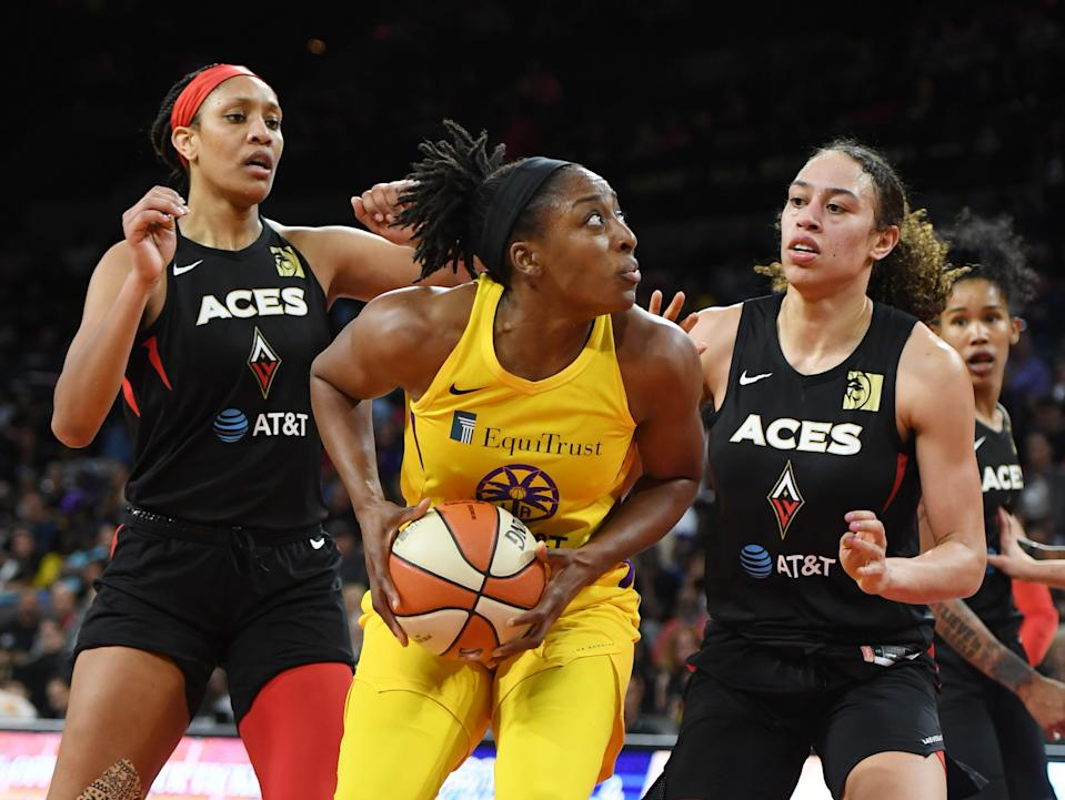 A'ja Wilson on the left and Dearica Hamby on the right guard the Sparks' Nneka Ogwumike.