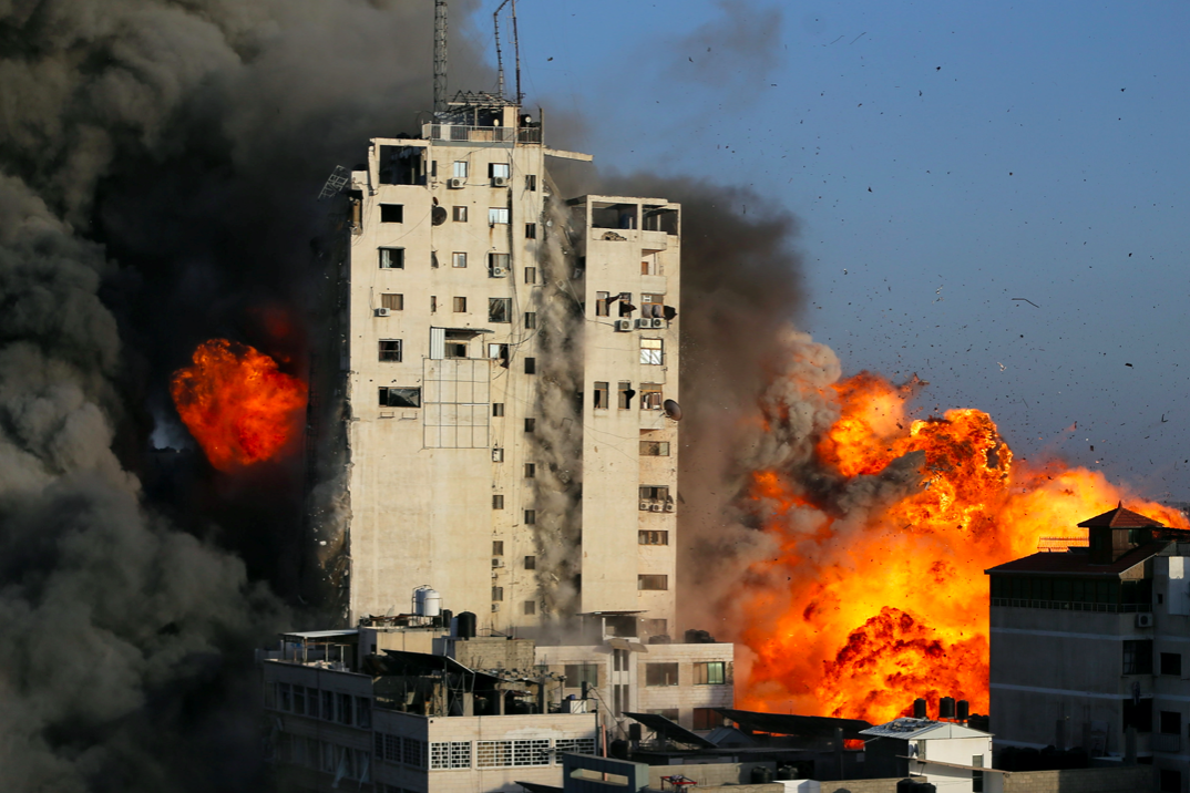 Smoke and flames rise from a tower building as it is destroyed by Israeli air strikes amid a flare-up of Israeli-Palestinian violence in Gaza City. (Reuters/Ibraheem Abu Mustafa)