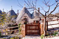"<p>Globe trotters will have to book flights to Italy for a chance to stay in the world's most popular Airbnb. For £64 per night, guests can reside at Sette Coni – which translates to the seven cones – in Ostuni. The stone cottage is located near to must-see tourist hotspots such as the caves of Castellana, the cities of Lecce and Martina Franca and the excavations of Egnazia.<br>According to the listing, it's a perfect location for nature lovers with a traditional patio area sitting pretty beneath an olive tree – we challenge you to find a greater location to read your new book. Don't believe us? A grand total of 164,444 Airbnb users have wish listed the property so far. <strong><a href=""https://www.airbnb.co.uk/rooms/432044"" rel=""nofollow noopener"" target=""_blank"" data-ylk=""slk:Book now"" class=""link rapid-noclick-resp"">Book now</a></strong>. <em>[Photo: Caters]</em> </p>"