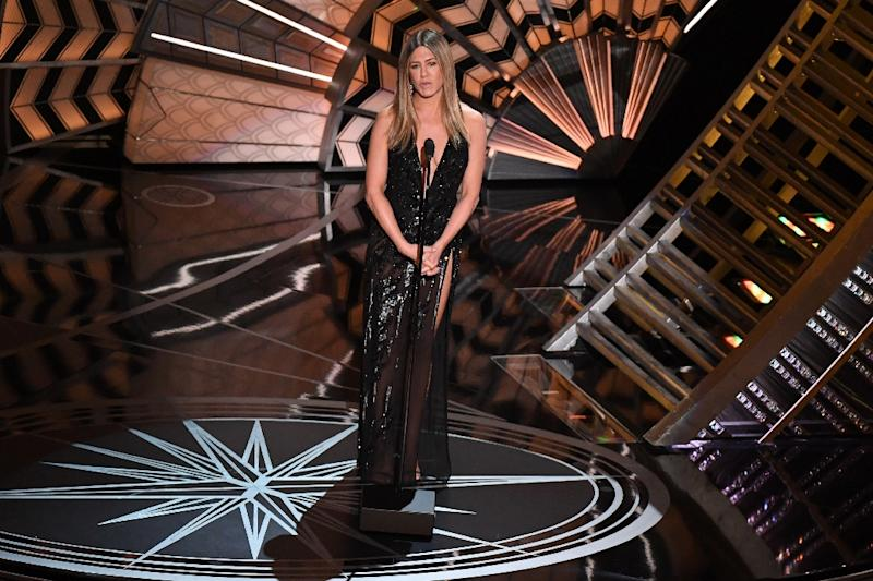 Jennifer Aniston, who introduced the 'in memoriam' section, gave an emotional tribute to actor Bill Paxton, who had died just one day earlier and was noticeably missing from the memorial reel (AFP Photo/Mark RALSTON)