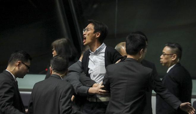 Carrie Lam is heckled by lawmakers including Eddie Chu at the legislature. Photo: Dickson Lee