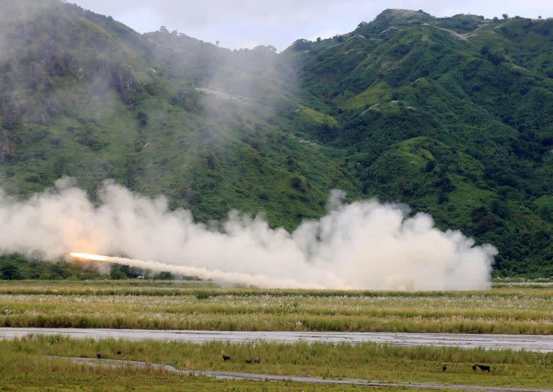 FILE PHOTO: U.S. military forces fire a High Mobility Artillery Rocket System (HIMARS) rocket during the annual Philippines-US live fire amphibious landing exercise (PHIBLEX) at Crow Valley, Tarlac province