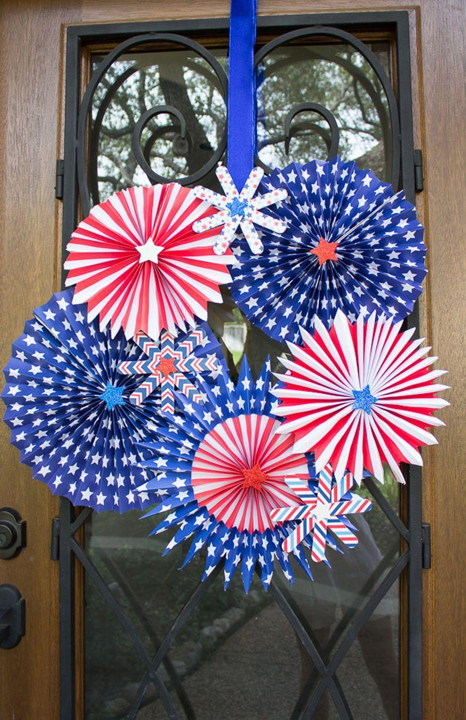 """<p>Fireworks are sure to last all day and night with this patriotic pinwheel wreath.<br></p><p><strong>Get the tutorial at <a href=""""http://www.designimprovised.com/2014/06/4th-of-july-wreath.html"""" rel=""""nofollow noopener"""" target=""""_blank"""" data-ylk=""""slk:Design Improvised"""" class=""""link rapid-noclick-resp"""">Design Improvised</a>.</strong></p><p><a class=""""link rapid-noclick-resp"""" href=""""https://www.amazon.com/Patriotic-Ddecorations-American-Independence-Supplies/dp/B07RN3Y6G9/ref=dp_prsubs_2?pd_rd_i=B07RN3Y6G9&psc=1&tag=syn-yahoo-20&ascsubtag=%5Bartid%7C10050.g.4464%5Bsrc%7Cyahoo-us"""" rel=""""nofollow noopener"""" target=""""_blank"""" data-ylk=""""slk:SHOP PATRIOTIC PAPER PINWHEELS"""">SHOP PATRIOTIC PAPER PINWHEELS</a></p>"""
