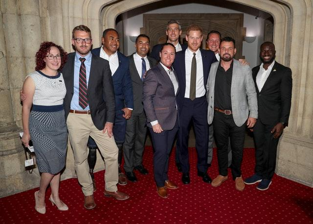 The Duke of Sussex with Invictus staff and competitors during a reception to celebrate the fifth anniversary of the Invictus Games at the Guildhall in central London