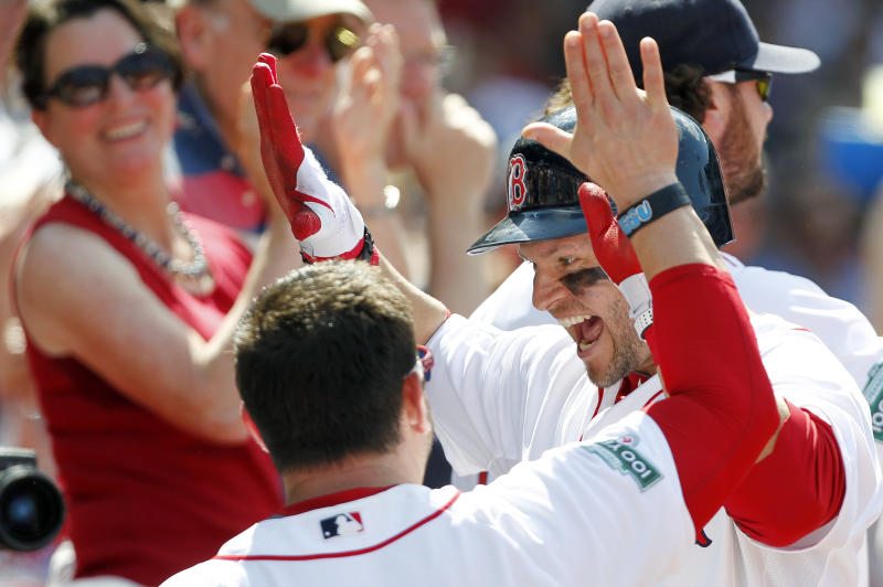 Boston Red Sox's Cody Ross, right, celebrates his two-run home run in the fifth inning of an interleague baseball game in against the Atlanta Braves Boston, Sunday, June 24, 2012. (AP Photo/Michael Dwyer)