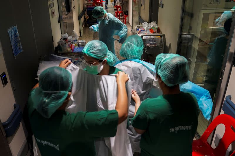 Medical workers take care of the coronavirus disease (COVID-19) patients in the ICU room in Bangkok