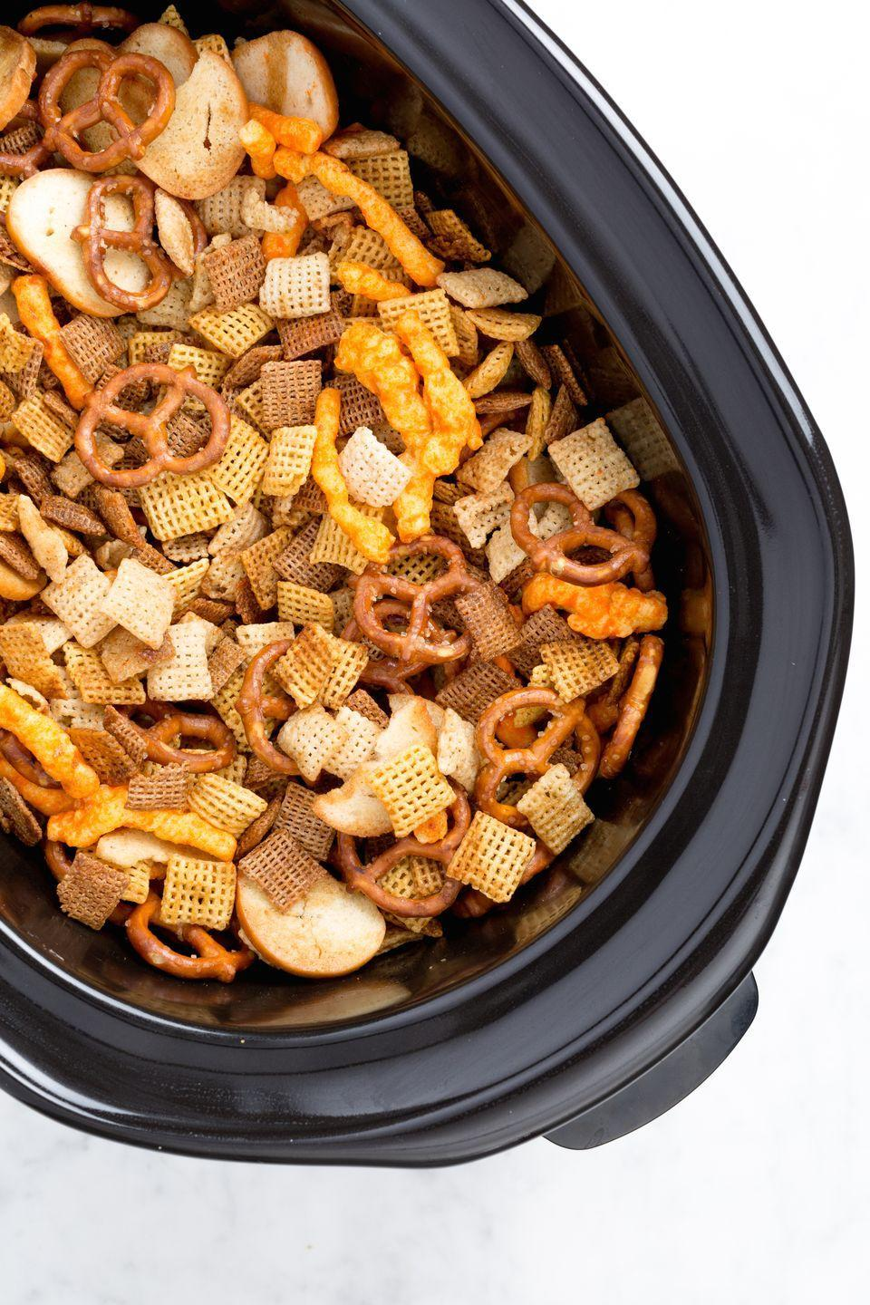 """<p>BYO snacks? We're ready.</p><p>Get the recipe from <a href=""""https://www.delish.com/cooking/a44358/slow-cooker-chex-mix/"""" rel=""""nofollow noopener"""" target=""""_blank"""" data-ylk=""""slk:Delish"""" class=""""link rapid-noclick-resp"""">Delish</a>. </p>"""